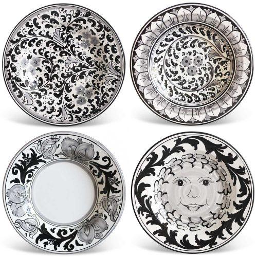 Piatti decorati neri ceramica Caltagirone