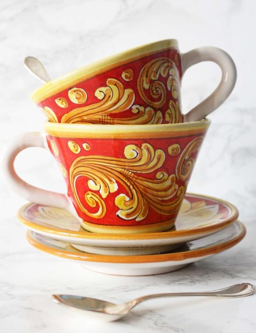 Decorated Caltagirone ceramic cup with saucer