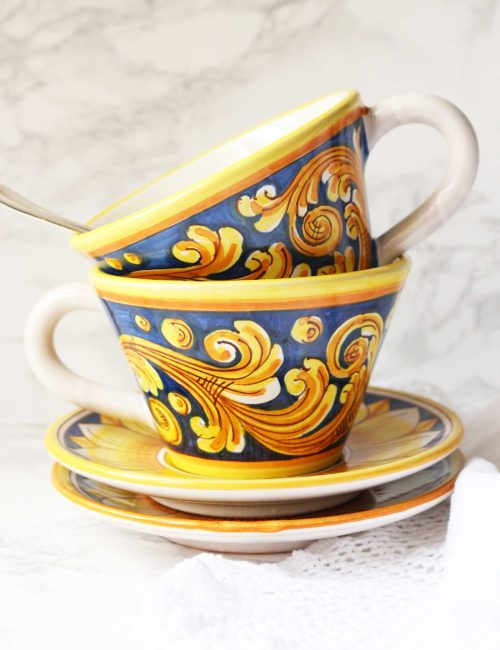 Handmade decorated ceramic cups and saucers
